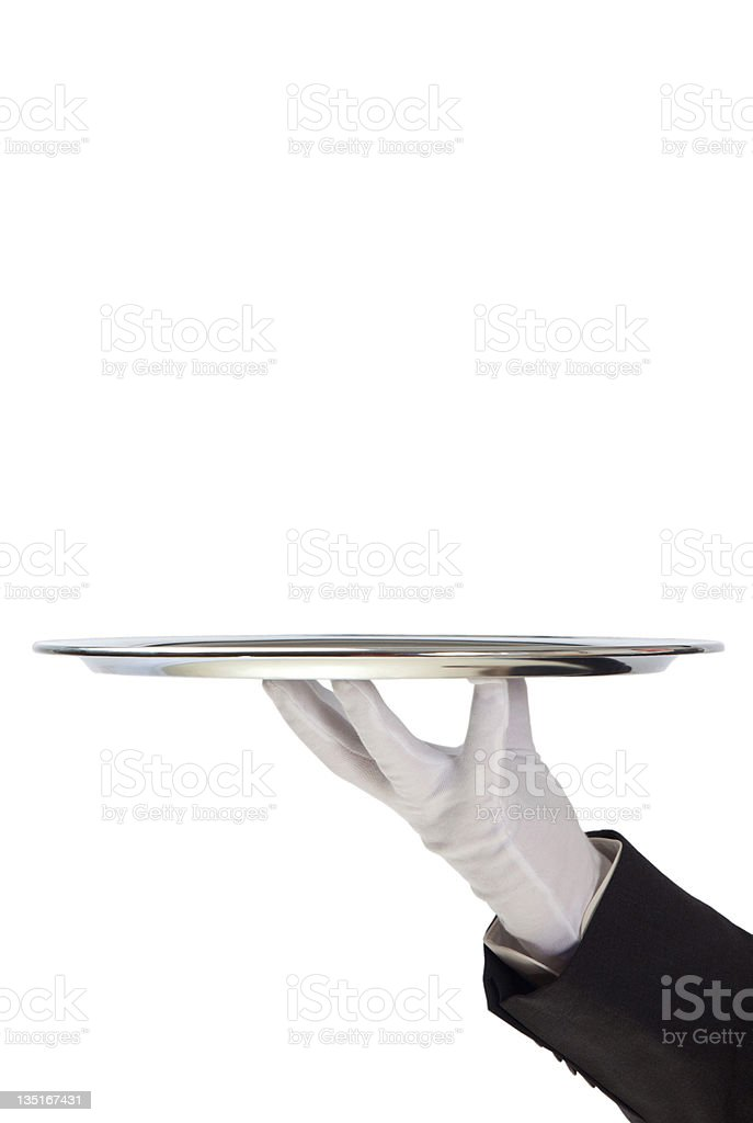 Butler holding empty silver tray in gloved hand royalty-free stock photo