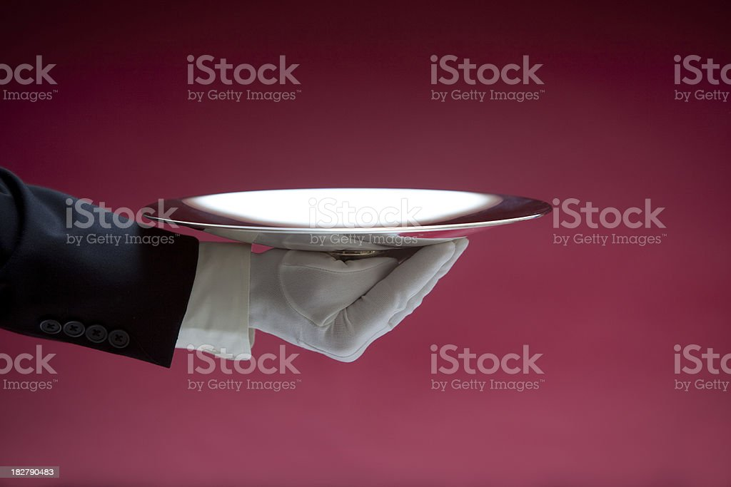 Butler Holding Empty Silver Tray on Red XXL stock photo