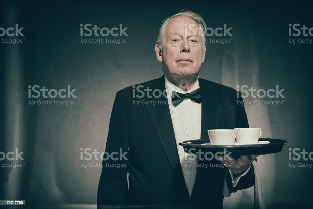 Butler Holding Tray with Two White Coffee Cups stock photo