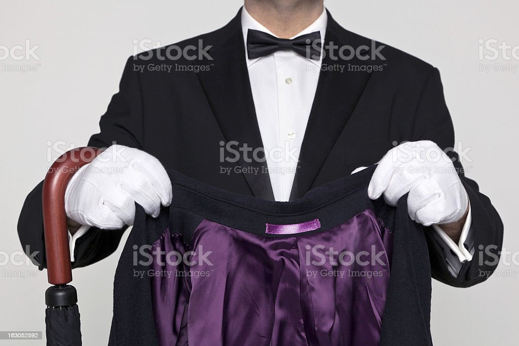 Butler holding your coat and umbrella. stock photo