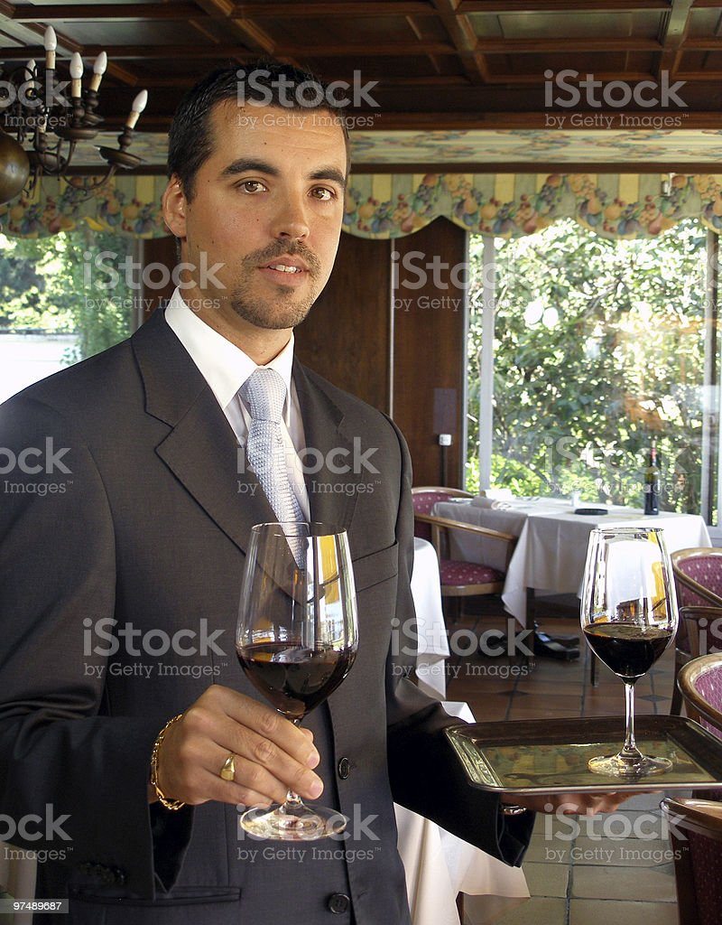 Butler is serving wine royalty-free stock photo