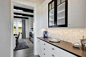 White cabinets and black accents give modern look to this new build