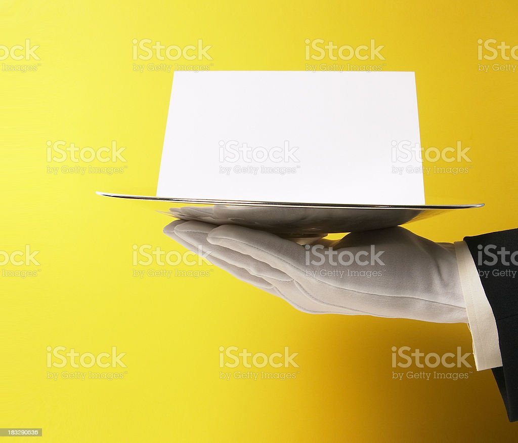 Butler Serving Blank Note on Yellow stock photo