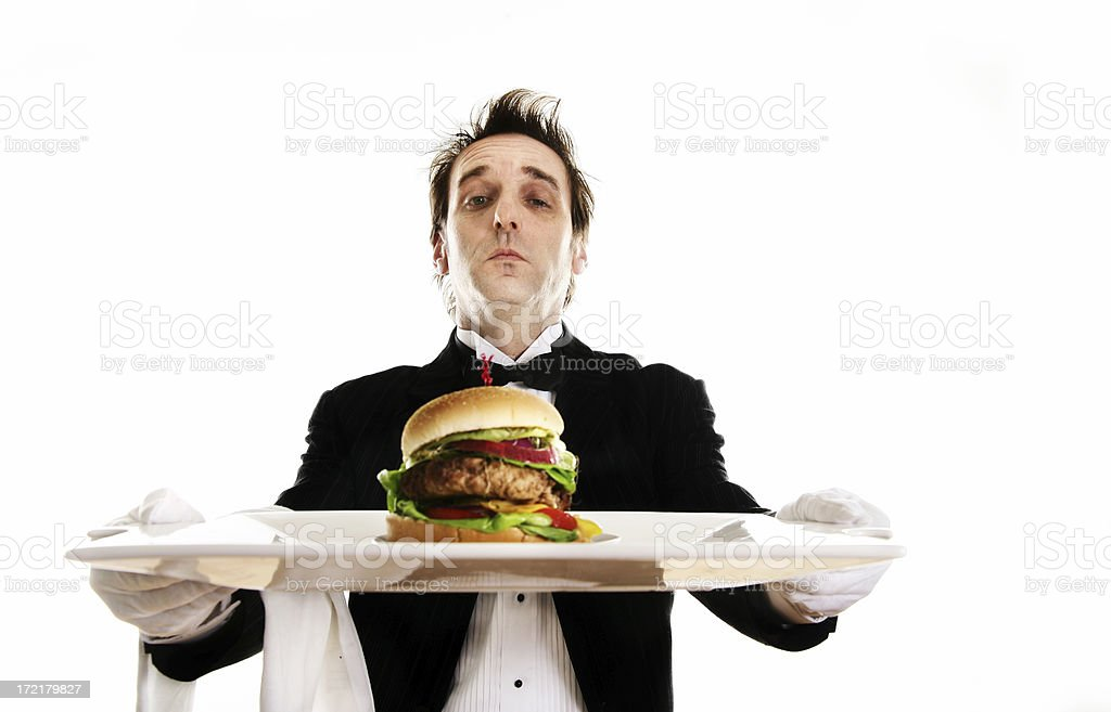 Butler serving dinner royalty-free stock photo