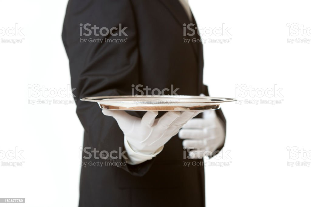 Butler Serving Empty Silver Tray on White stock photo
