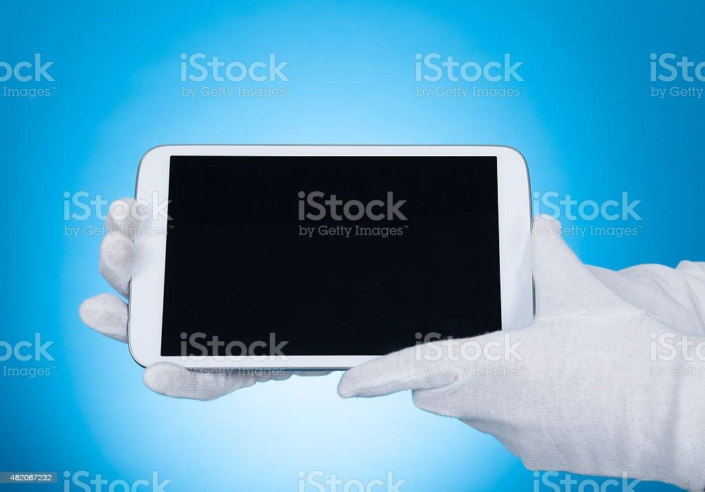 Butler Showing Digital Tablet stock photo