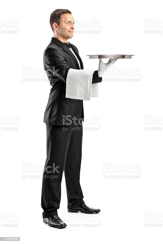 Butler with bow tie carrying an empty tray royalty-free stock photo
