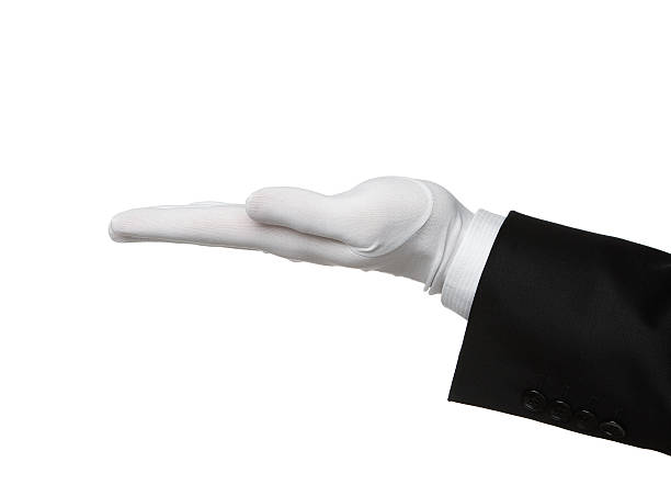 Butler's hand offering product stock photo