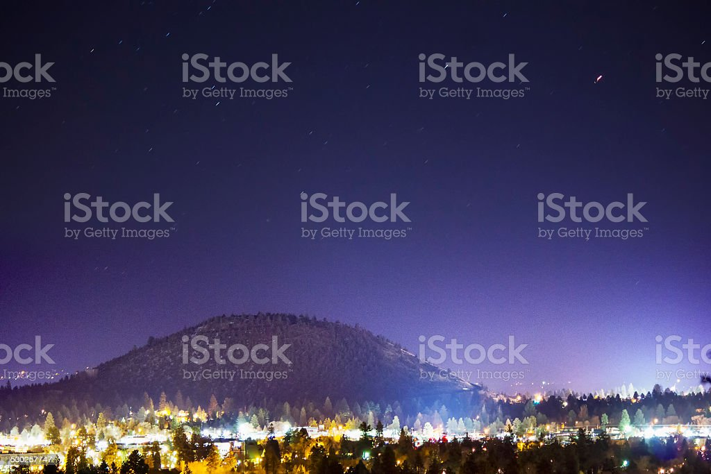 Butte in a city at night stock photo
