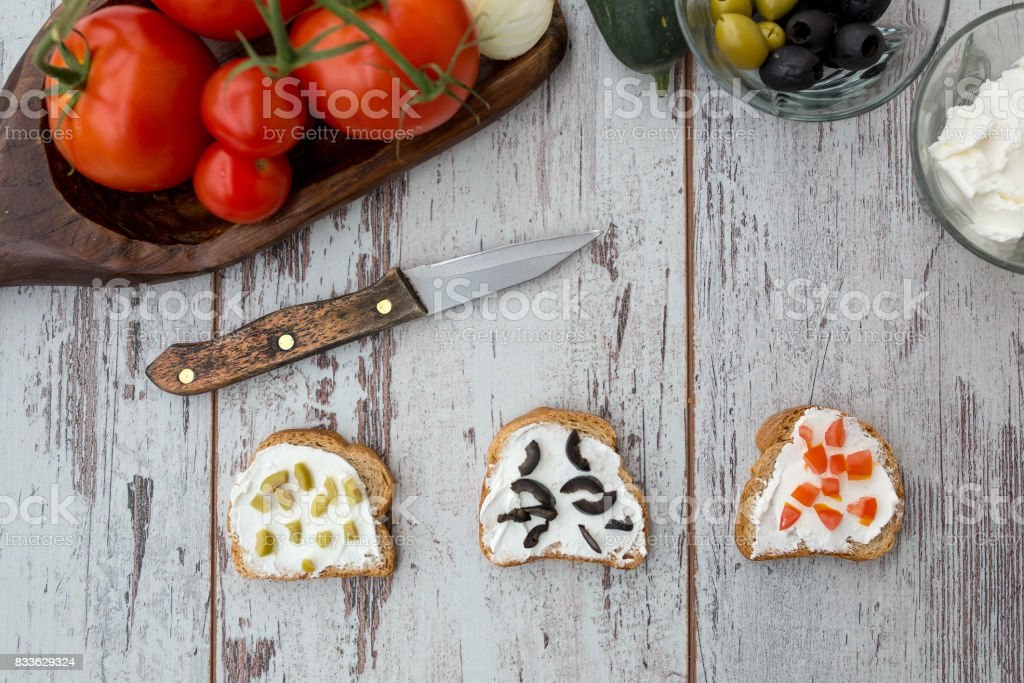Butter and bread for breakfast, over rustic wooden background close up stock photo