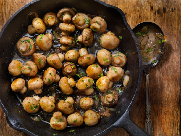Butter and Garlic Mushrooms with Onions stock photo