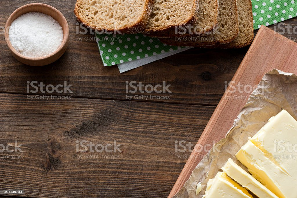 butter, bread and salt top view stock photo