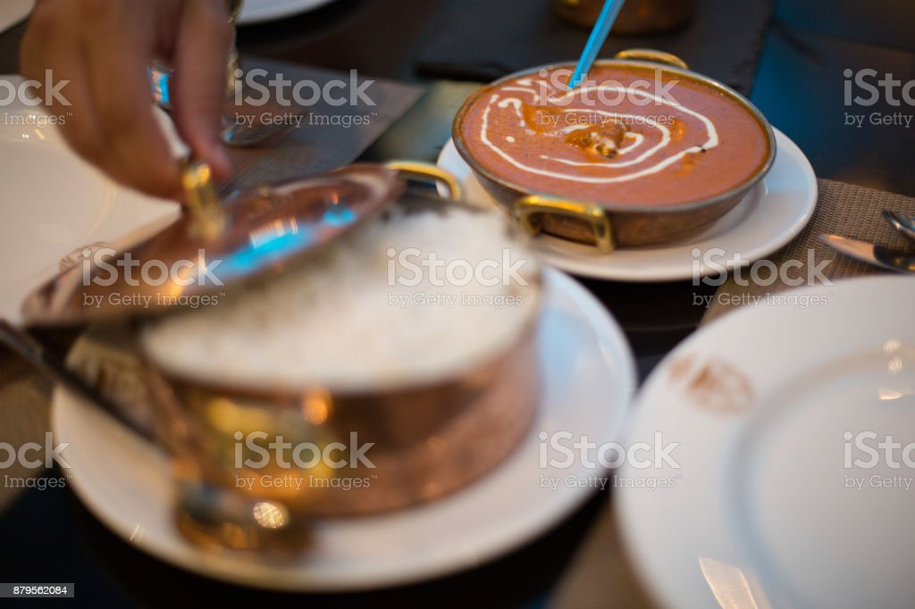 Butter chicken and rice in Indian Restaurant stock photo