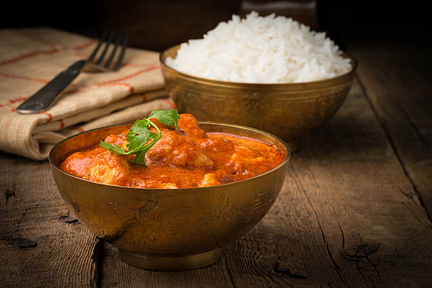 Butter Chicken Bowl Authentic Indian butter chicken served with white rice. butter chicken stock pictures, royalty-free photos & images