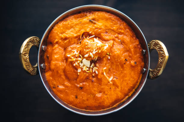 Butter chicken curry inside Karahi Indian Serving Dishes. North Indian food Butter chicken curry inside Karahi Indian Serving Dishes. North Indian food butter chicken stock pictures, royalty-free photos & images