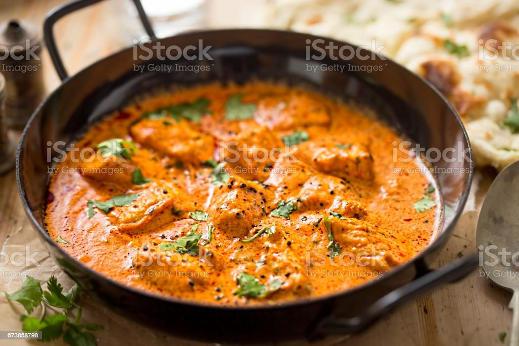 Butter chicken curry with tender chicken breast, cream, butter & honey stock photo