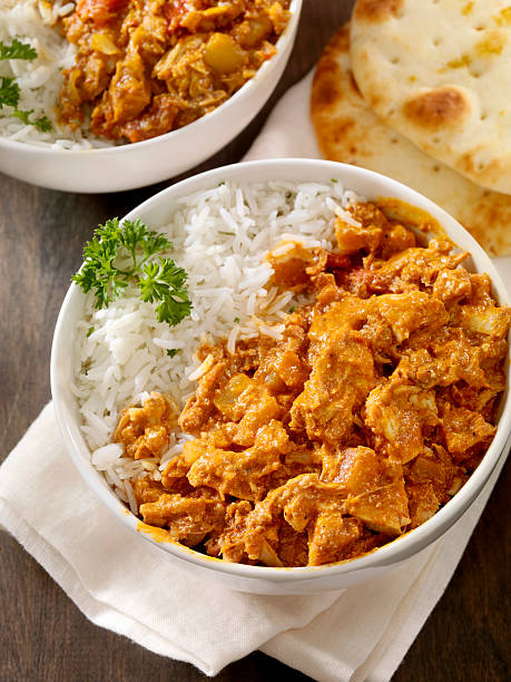 Butter Chicken Butter Chicken with Basmati Rice and Naan Bread -Photographed on Hasselblad H1-22mb Camera butter chicken stock pictures, royalty-free photos & images