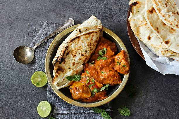 Butter Chicken served with homemade Indian Naan bread Butter chicken served with Homemade Indian Naan Bread / Murgh Makhani garam masala stock pictures, royalty-free photos & images