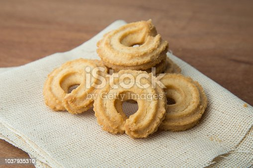 istock Butter cookies on white linen on wooden table 1037935310