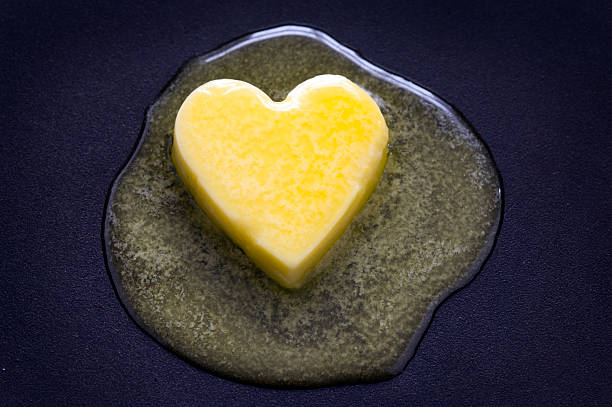 butter heart melting stock photo