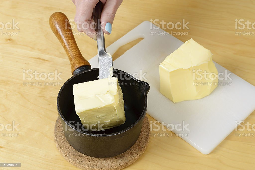 Butter in pan stock photo
