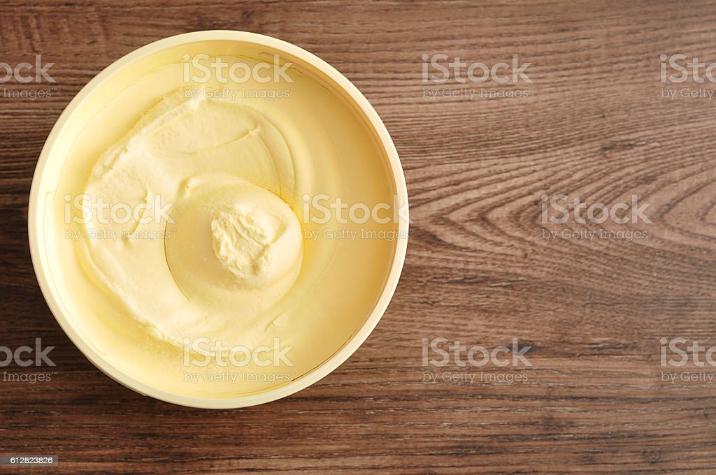 Butter isolated on a wooden background stock photo