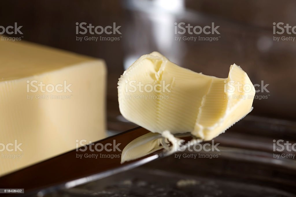 Butter knife and butter stock photo