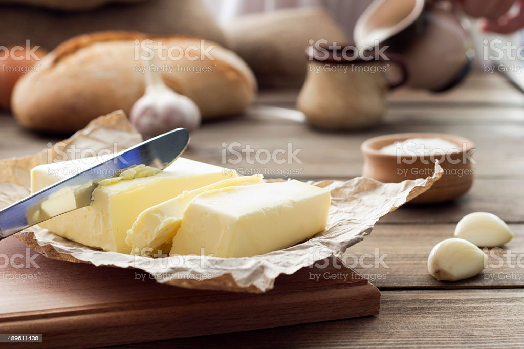 butter knife , bread , garlic and milk - Royalty-free 2015 Stockfoto