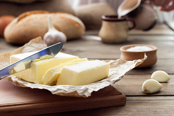 butter knife , bread , garlic and milk stock photo