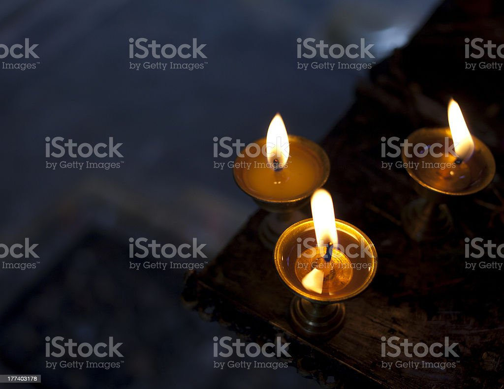 Butter lamps used for prayers in a hindu temple. stock photo