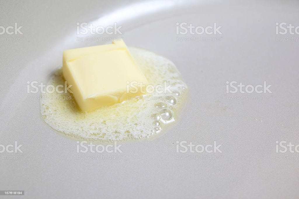 Butter Melting in Pan stock photo