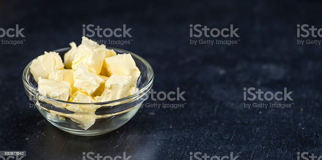 Butter on a slate slab (selective focus) stock photo