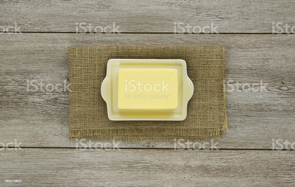 Butter on dish with burlap stock photo
