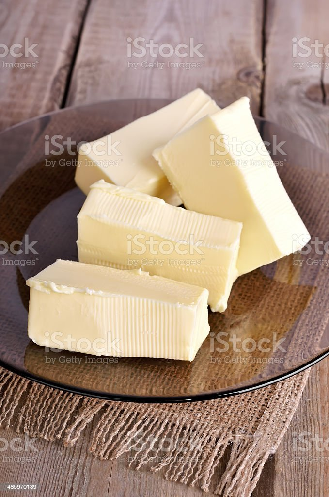 Butter on glass plate stock photo