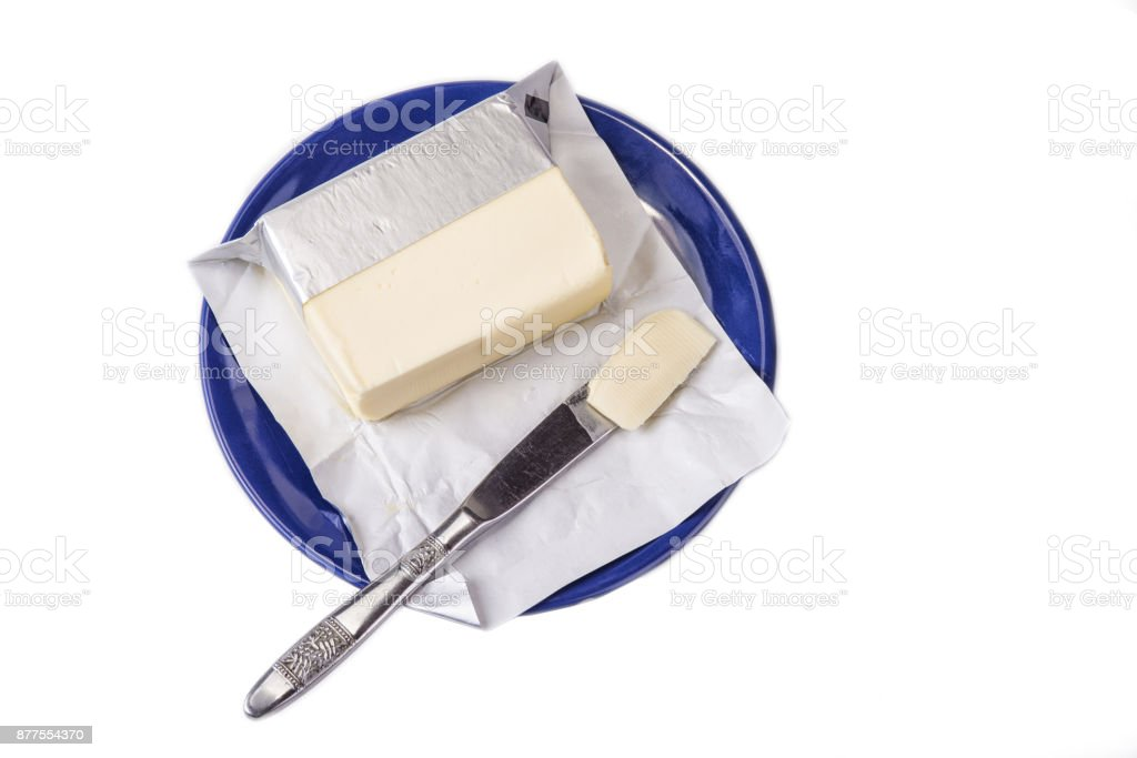 Butter on the blue plate  on the white background. stock photo