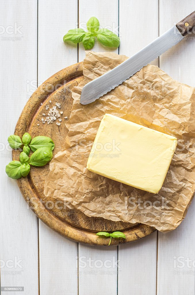 Butter on white wooden background. stock photo