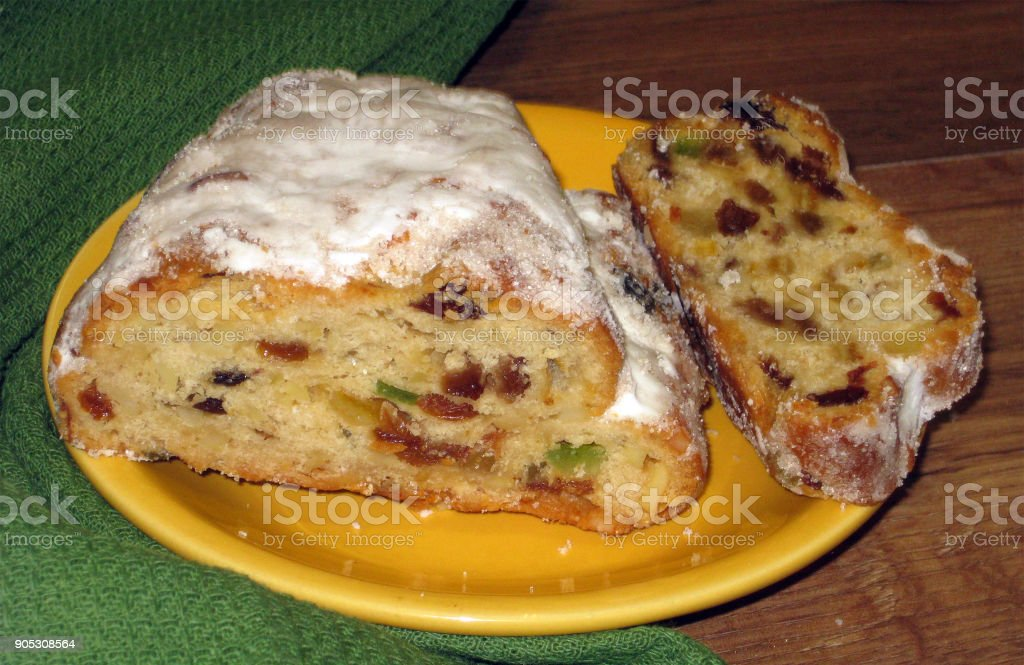 butter stollen - typical German Christmas fruited breads stock photo