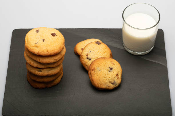 Butter Toffee Crunch Chocolate Chip Cookies with a milk drink