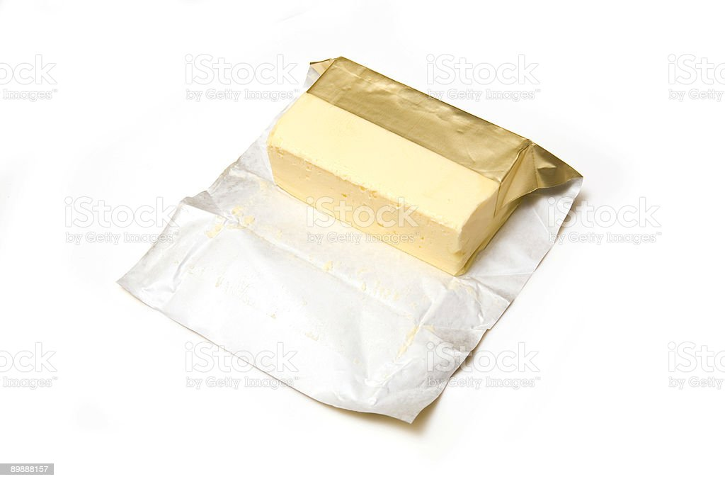 Butter with foil wrapper royalty-free stock photo