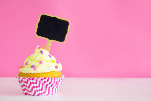 Buttercream cupcake with blank sign stock photo