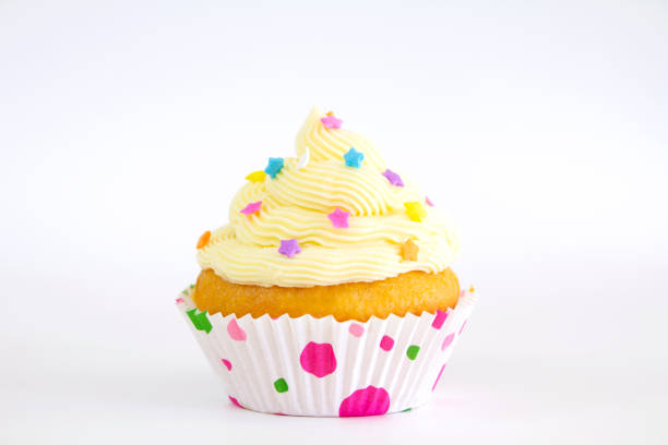 Buttercream cupcake with sprinkles stock photo