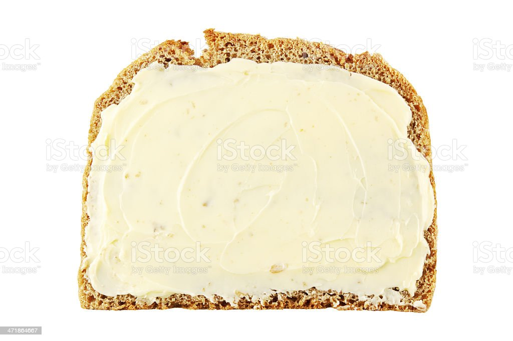 A buttered piece of bread isolated on a white background stock photo