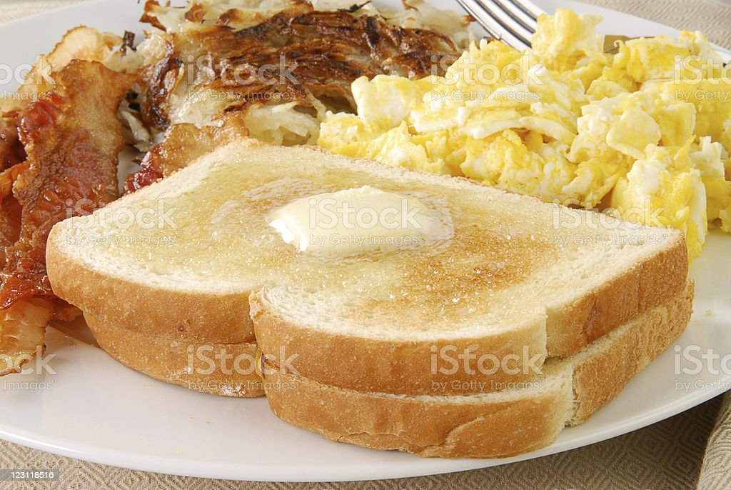 Buttered toast with bacon and eggs stock photo