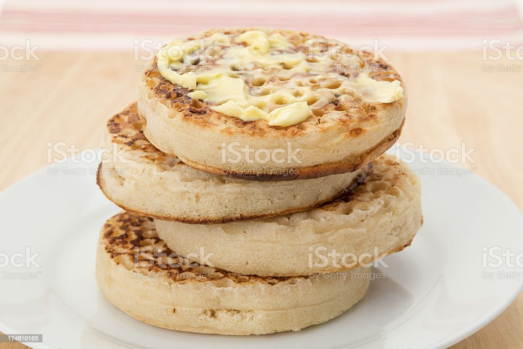 Buttered toasted crumpets royalty-free stock photo