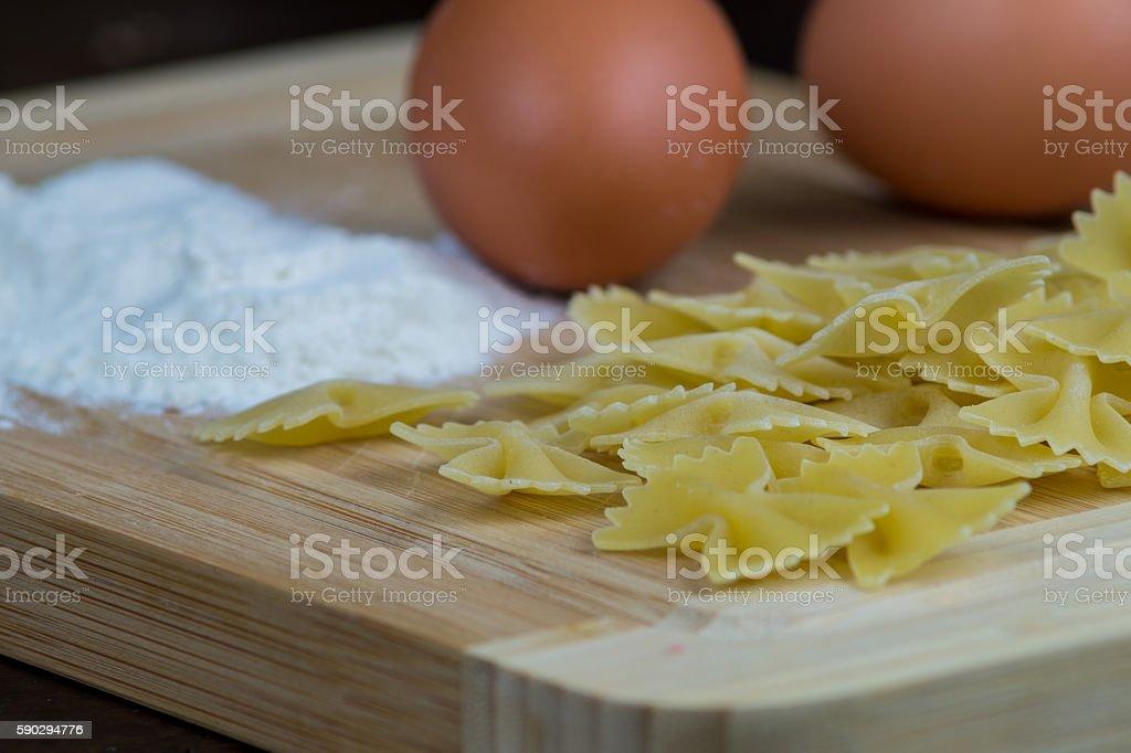 Butterflies homemade with flour, eggs and rolling pin Стоковые фото Стоковая фотография