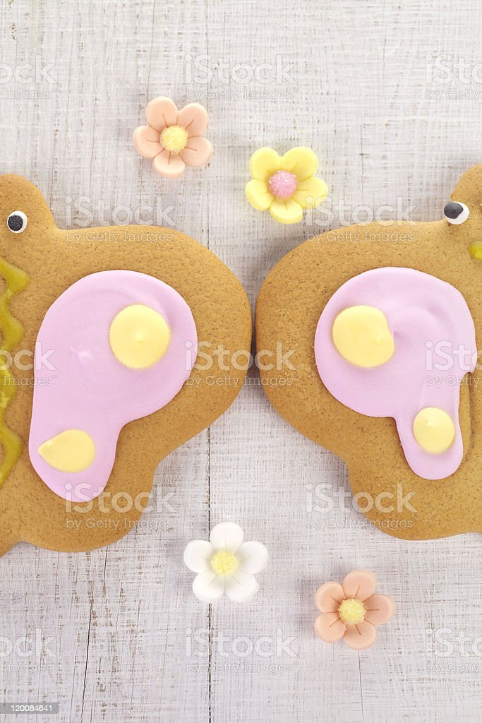 butterfly  ginger cookies with sugar flowers on old white table royalty-free stock photo