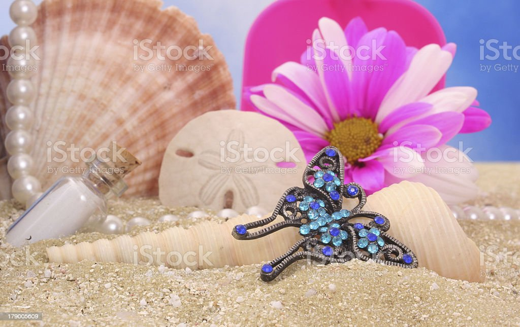 Butterfly Jewelry on Beach royalty-free stock photo
