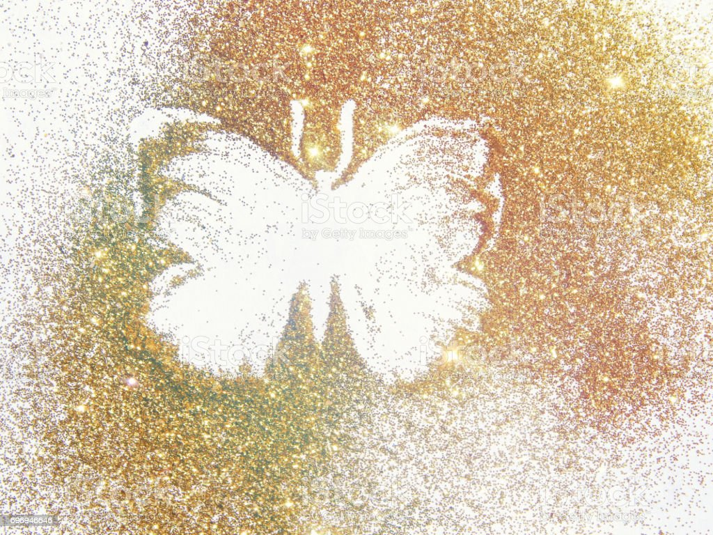 Butterfly on the golden glitter.  Beautiful background for your design stock photo