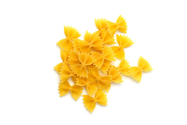 Pasta farfalle Farfalle pasta uncooked white background bow tie pasta stock pictures, royalty-free photos & images