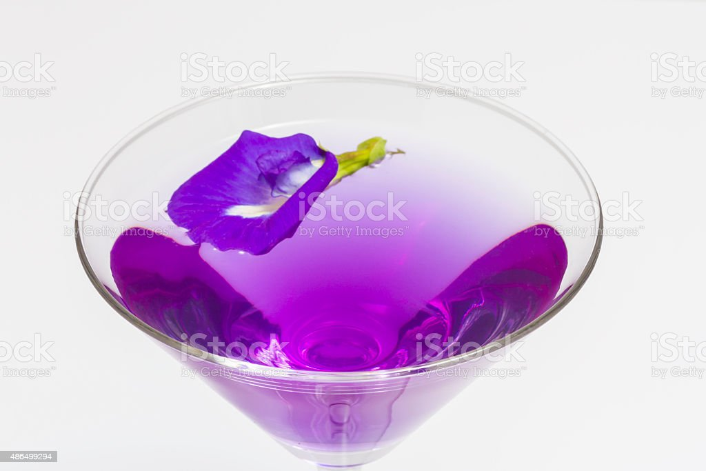 Butterfly pea flower juice in cocktail glass stock photo